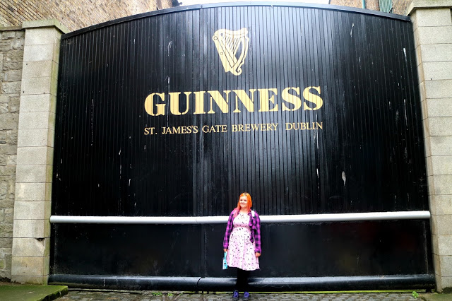woman in front of Guinness factory door