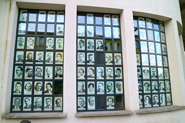 Window's with images of the workers of Schindler's factory
