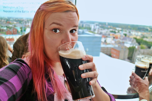 Kariss drinking a pint of Guinness at the Guinness factory in Dublin