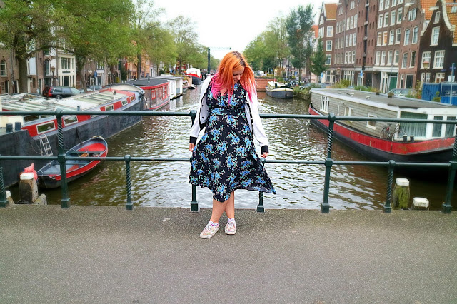 woman on a bridge in Amsterdam in a floral dress