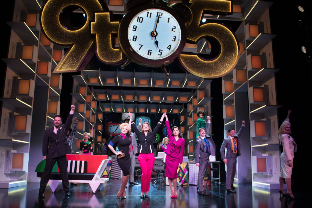 performers on stage at the 9 to 5 musical
