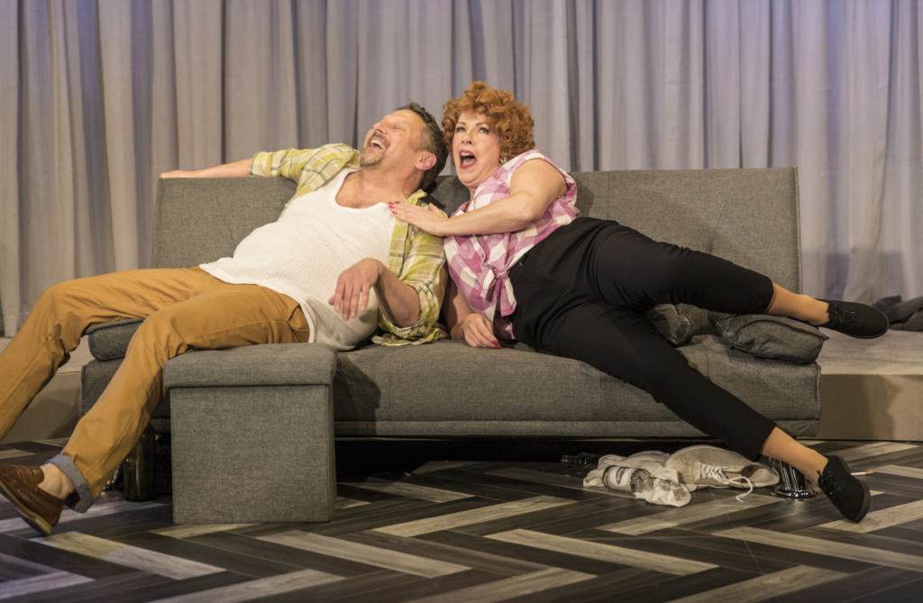 Actor and Actress from GOODBYE NORMA JEANE laughing on a couch
