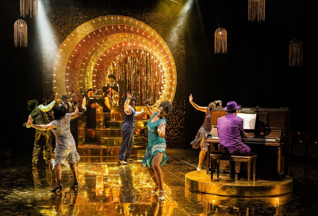 Cast of Ain't Misbehavin' dancing on stage at the Southwark Playhouse