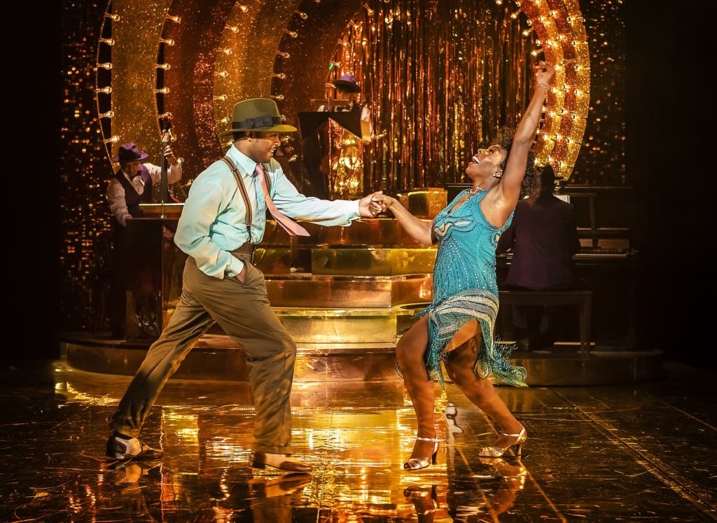 Two performers from Ain't Misbehavin' swing dancing on stage at the Southwark Playhouse