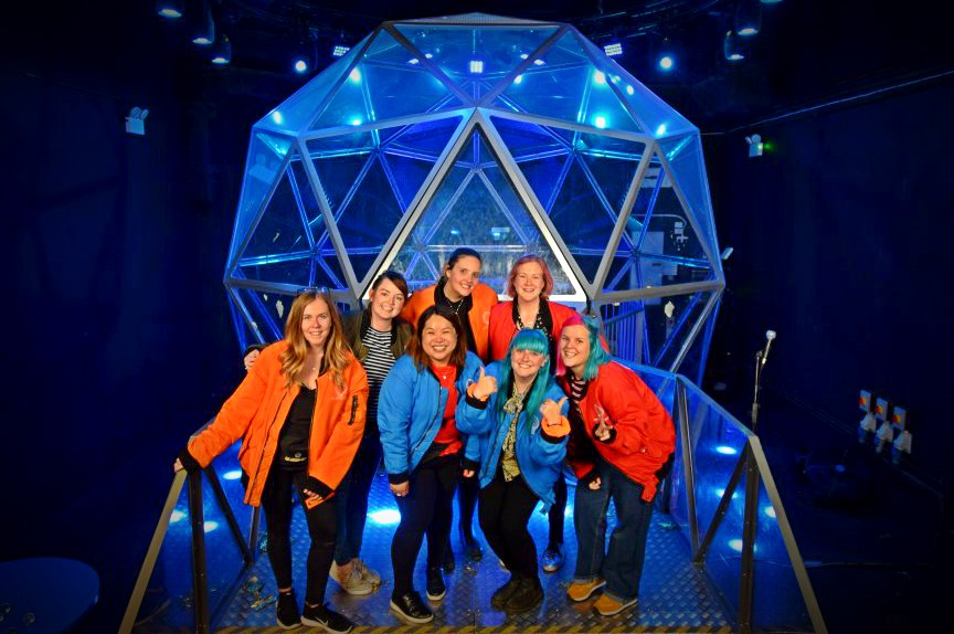 group of women in front of the crystal dome at the crystal maze experiance