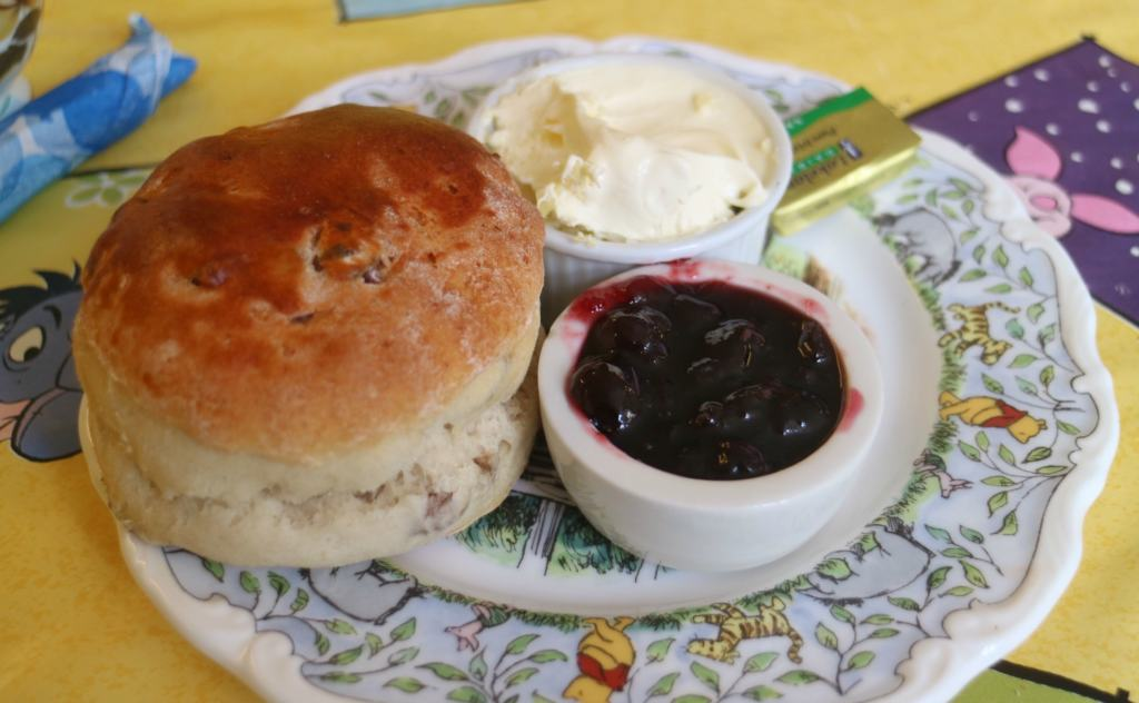 english scone with creme and jam on winnie the pooh plate