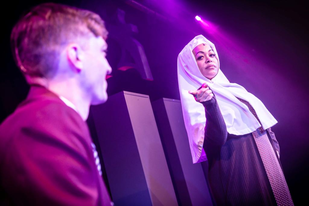 school boy and nun in Bare: The Popup Opera