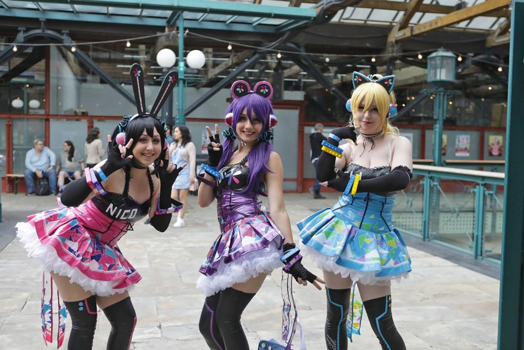 three girls in cosplay outfits at Hyper Japan