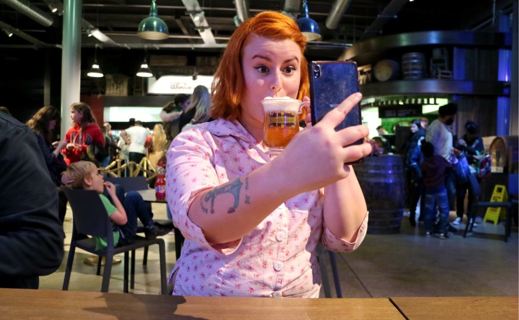 woman drinking butter beer at the harry potter studio tour