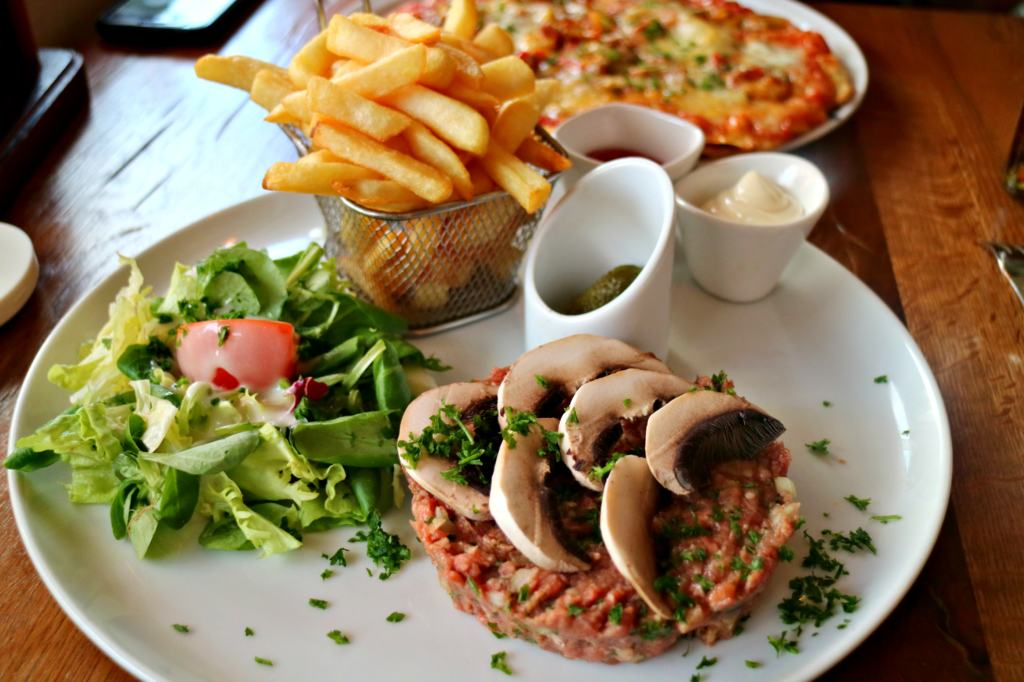 steak tartare with salad and fries in Dunkirk