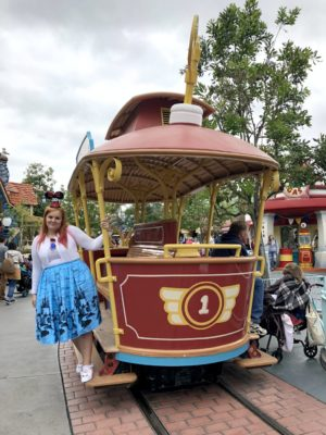 woman on trolly in DIsneyland