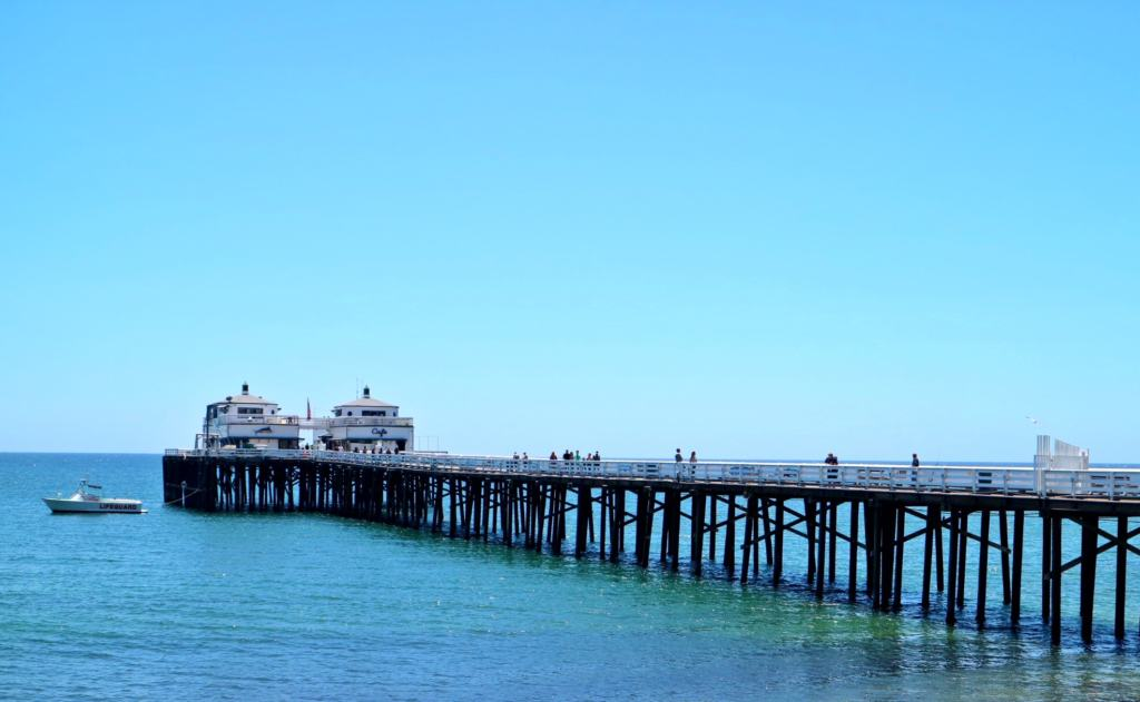 Malibu pier with blue sky and sea on the Pacific Coast Highway