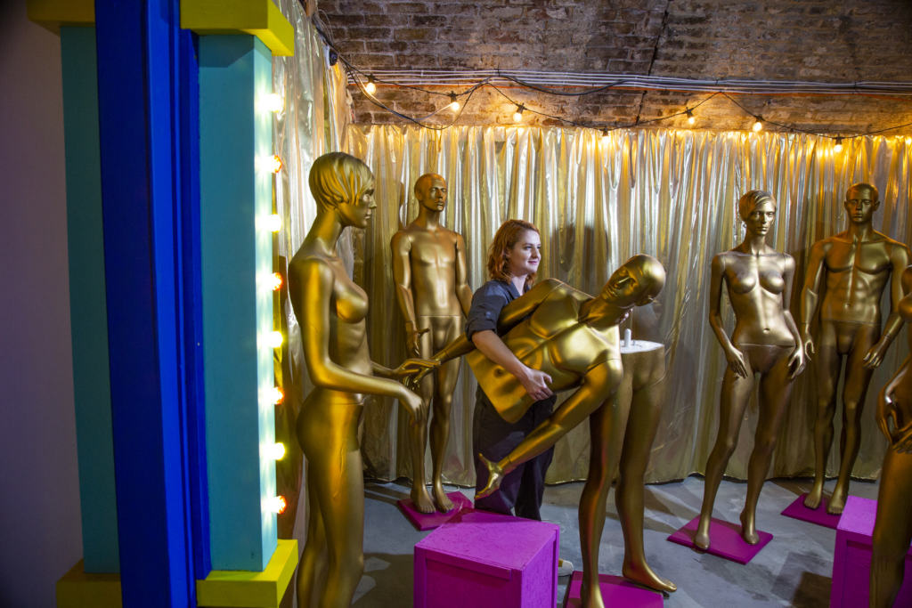 woman with gold mannequins inside Chambers_