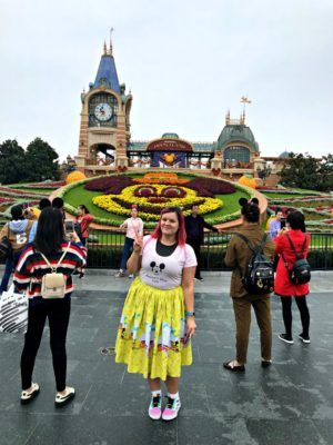 woman in front of vampire Mickey floral display