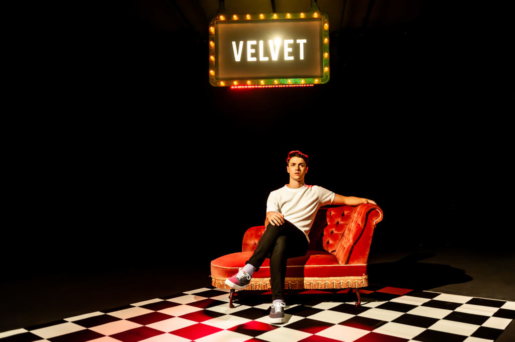 Actorr on the stage of Velvet at above the stag theatre