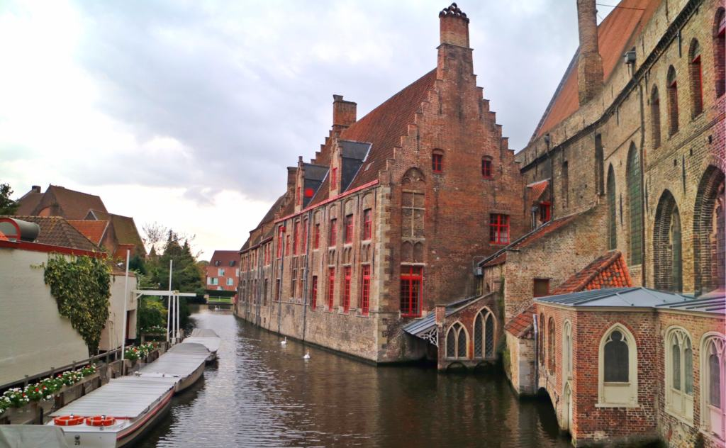 Canal of Brugge running next to a church
