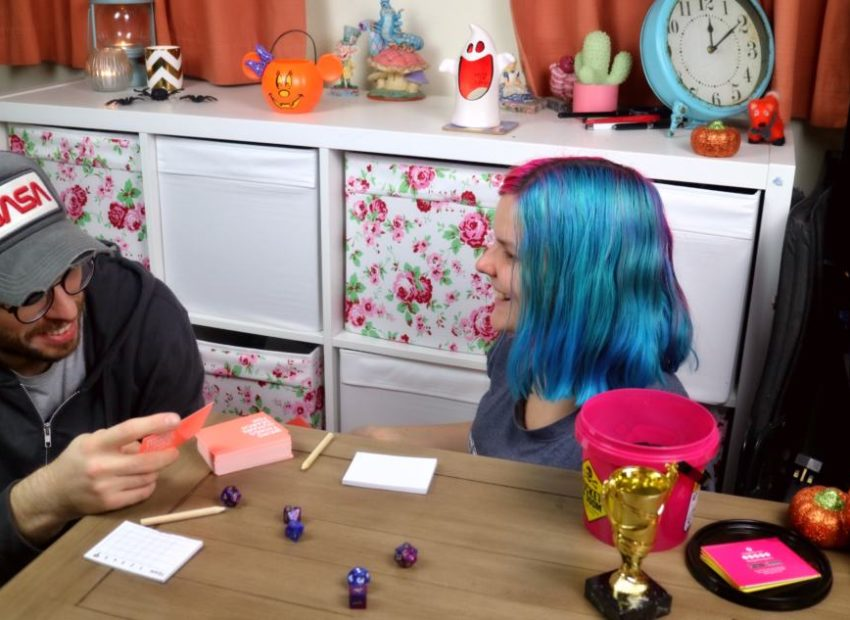 two people enjoying a board game