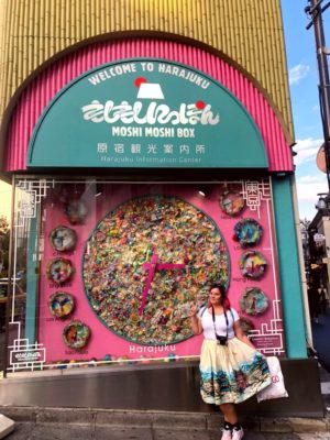 woman in front of Harajuku sign during Halloween in Tokyo