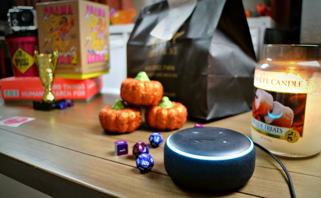 an Alexa dot on a game table for Planning a game night
