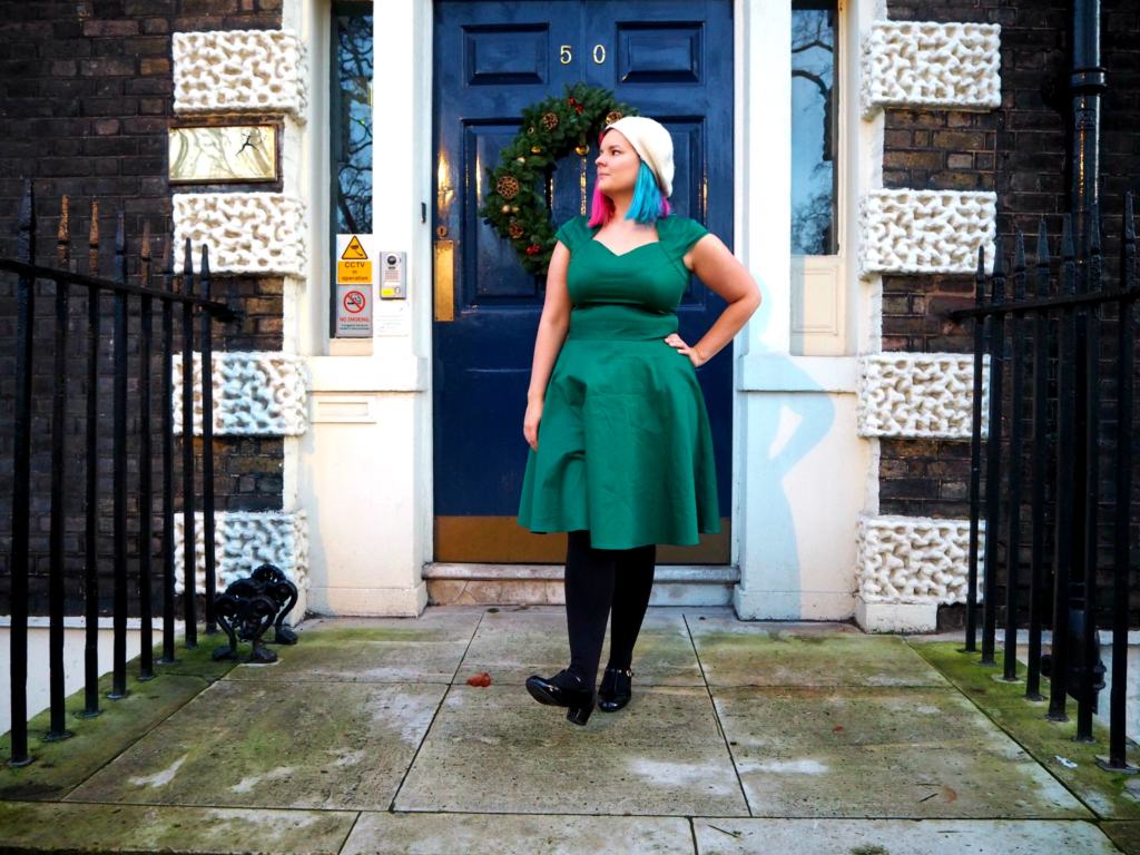 Kariss in the Green Midi Dress in front of a door