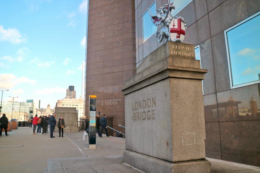 Exploring London Bridge at the London Bridge sign