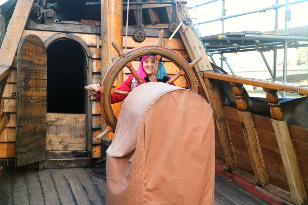 Kariss behind the wheel of the ship when exploring London Bridge