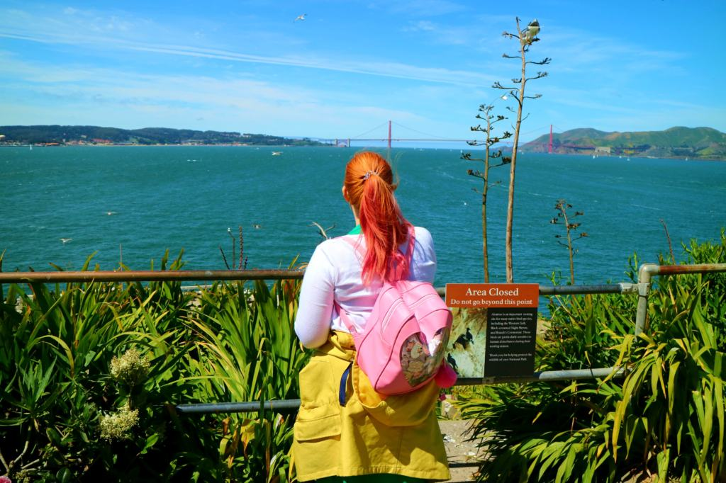 Kariss overlooking the golden gate Bridge from Alcatraz Island