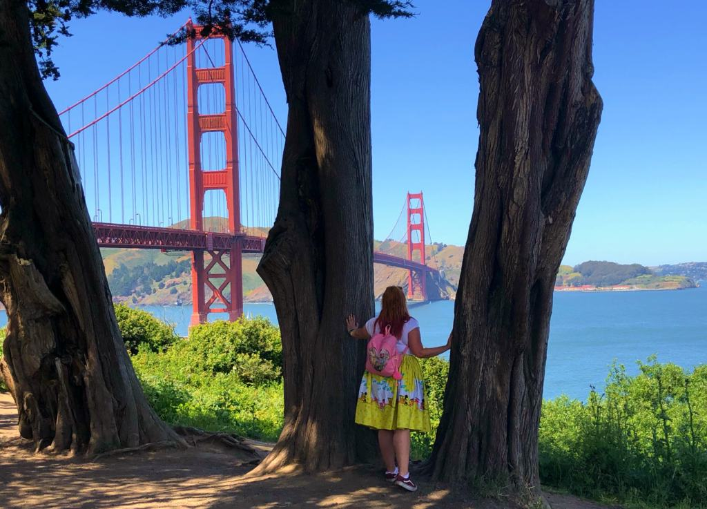 kariss taking in the view from the golden gate bridge from behind the trees
