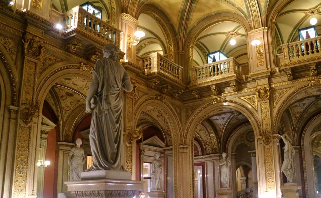 decorative statues in the grand staircase on the Vienna Opera House tour