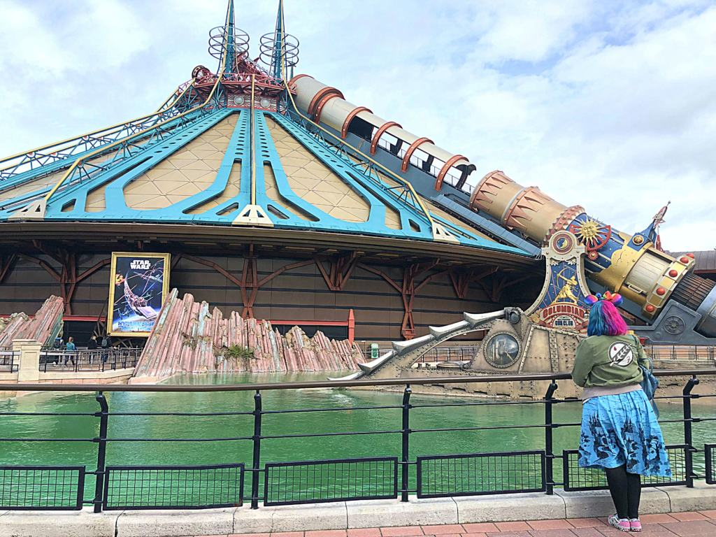 Kariss facing away from the character in front of Space Mountain in Disneyland Paris