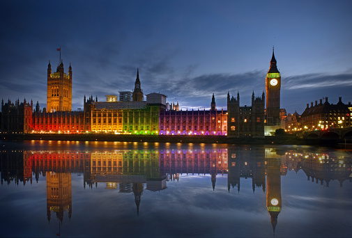 The Houses of Parliament illuminated and reflecting rainbow colours for the Gay LGBTQ+ Pride in London for Pride at Parliament