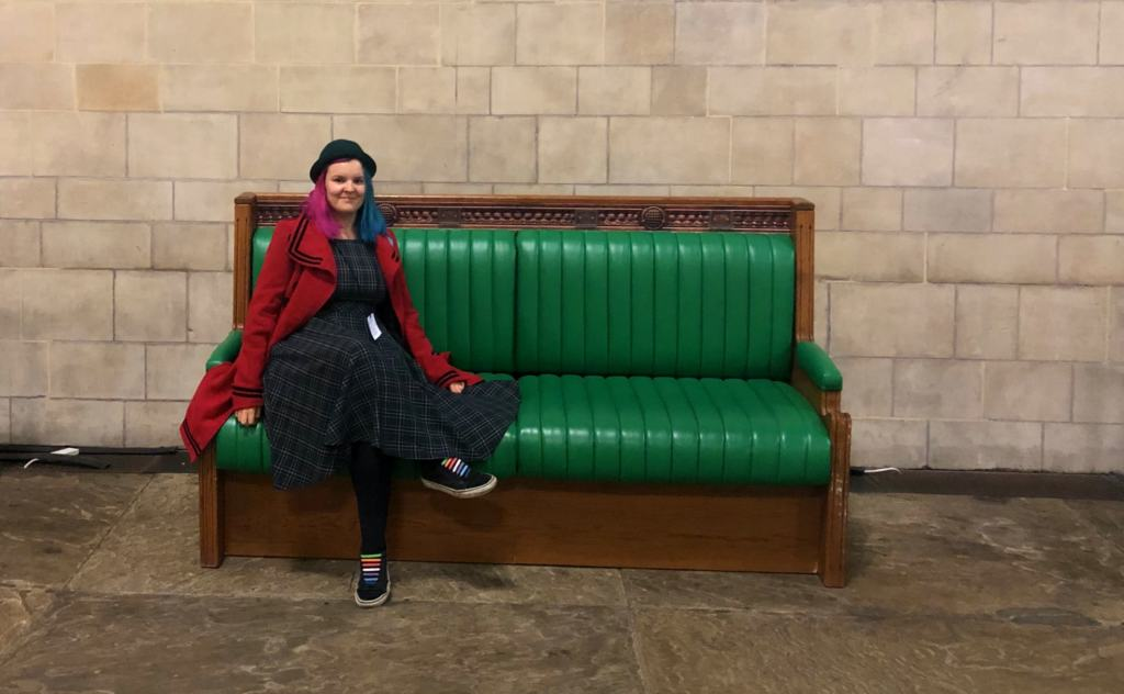 Kariss on a Parliament style bench on the Pride at Parliament